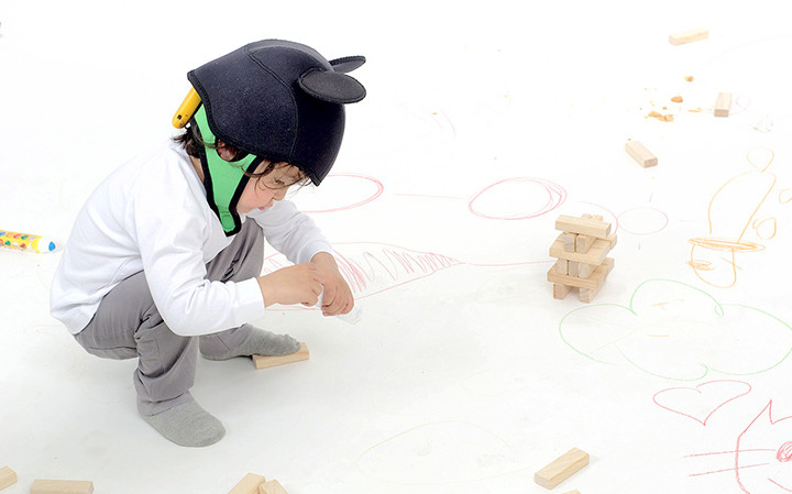 kid-with-neoprene-headcap-neuroelectrics
